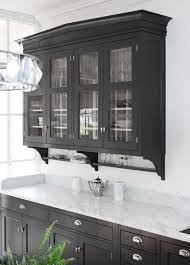 black cabinet with glass doors black kitchen cabinet love these along with the glass doors would