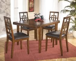 ashley d295 225 cimeran 5 pc medium brown dining table and chairs
