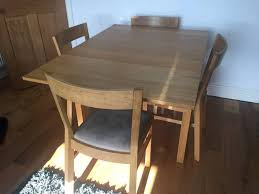ikea bjursta extending dining table and four solid oak ikea roger