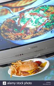 cuisine tv programme concept to unhealthy fast food tv dinner in front of stock