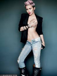 bare breast miley cyrus strips cups bare breast and flashes
