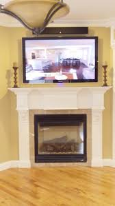 tv over fireplace with sound bar above home theater pinterest