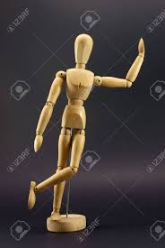 articulated wooden doll or artist s model supported stock photo