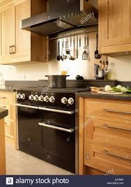 Kitchen Extractor Range Oven With Extractor Fan In Kitchen With Wood Fitted Units