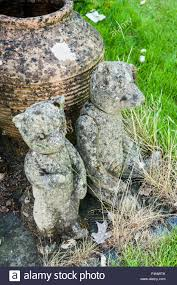 cast concrete teddy bears used as garden ornaments stock photo