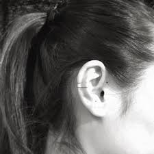 two lines and three dots on the right ear artist