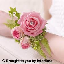 pink corsage pink fern wrist corsage blakes of bookham great bookham