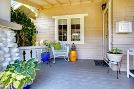 covered entrance porch with plants and chair stock image image