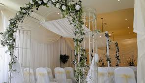 wedding flower arches uk traditional white draping with wedding arch and canopy