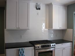 interior white glass tile backsplash with white cabinet glass