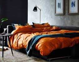 Friheten Corner Sofa Bed A Living Room With A Corner Sofa Bed Made With Orange Quilt Cover