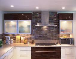 modern glass wall kitchen cabinet and mosaic tile backsplash also