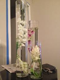 orchid centerpieces trial run with real and submerged orchid centerpieces