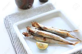 yuzu cuisine japanese cuisine grilled shishamo smelt on dish with yuzu stock