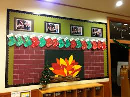 christmas bulletin board fireplace with child made stockings and