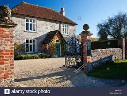a typical english stone country farmhouse in broad chalke