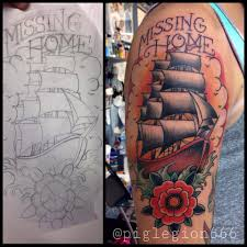 traditional ship with rose tattoo on man right half sleeve