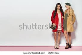 royalty free fashionable two women in coat and nice u2026 510895084