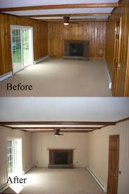 painting paneling in basement before and after old wall paneling primed and painted