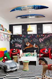 fun playroom with chalkboard accent wall as well as a pair of