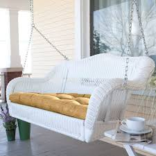 white resin wicker porch swing with comfort spring and hanging