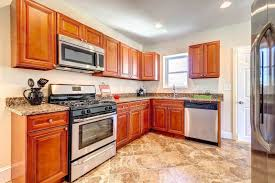 amazing kitchen build up with ceramic flooring and wooden cabinets