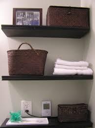 Bathroom Shelving Ideas Various Dark Tone Wooden Floating Shelves On White Painted Wall