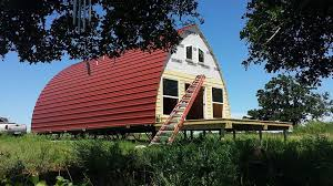 Prefabricated Arched Cabins Can Provide A Warm Home For Under Metal Home Designs