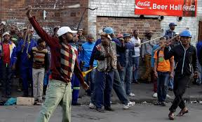 A crowd of anti immigrant protesters demonstrate outside the Jeppe hostel in Johannesburg  South Daily Mail