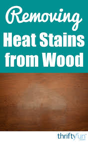 how to remove white spots of wood furniture removing white heat stains from a wood table thriftyfun