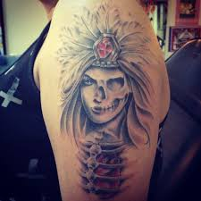 scary aztec women and skull tattoo collaboration on sleeve