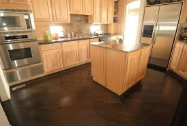 honey oak kitchen cabinets with wood floors light maple cabinets vs floors it s not completely