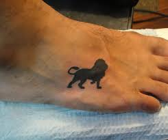 small black lion tattoo on foot photos pictures and sketches