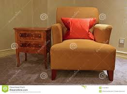 classic design of single seater sofa chair and side table stock
