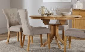 round extending dining room table and chairs hudson round oak extending dining table with 4 bewley oatmeal