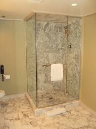 small bathroom with walkin open shower no door small rug on the