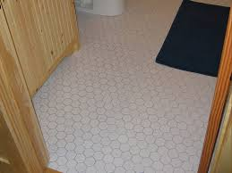 simple 28 bathroom with patterned floor on how to lay self