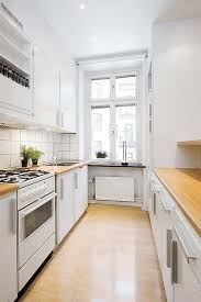 galley small apartment kitchen design with butcherblock countertop