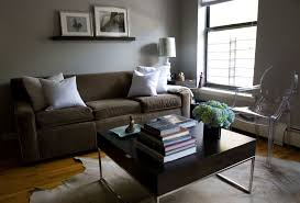 simplistic dark fabric midcentury gray couch with black cube
