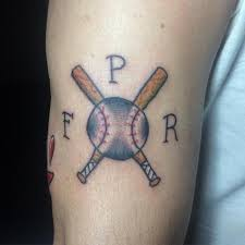 perfect cross baseball and initials tattoo on half sleeve