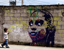 street art painting of a child on wall by the artist stinkfish native of bogotá