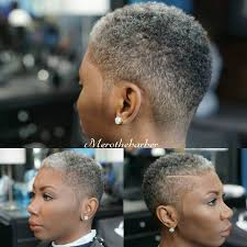 fade haircut with a part on a woman tapered short haircuts