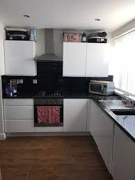 black worktop white cupboards kitchen kitchen cupboards and worktop