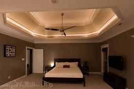 bed lighting slanted ceiling bedroom sleek white bedside drawer pure white
