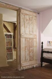 Sliding Barn Closet Doors by Turn A Regular Door Into A Sliding Barn Door Barn Doors Barn