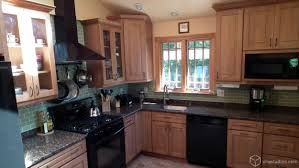 a beautiful traditional kitchen with maple kitchen cabinets from