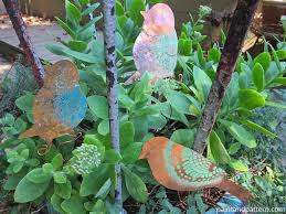 use stencils to create diy garden ornaments paint pattern