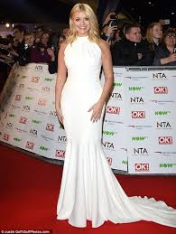 willoughby dresses willoughby flaunts slim in a white gown at