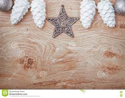 card with white ornaments on rustic wooden b