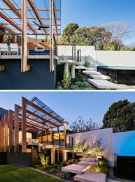 Pool With Pergola by This House Extension Has A Modern Pergola That Leads To A Swimming